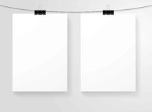 Paper blank sheets vector  hanging on clips. Blank paper sheets hanging on clips. Vector  mock up template on gray background Royalty Free Stock Image