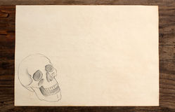Paper blank skull hand draw wooden Stock Photo
