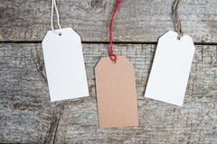 Paper blank tag on old wooden background. Special sales, discounts. Royalty Free Stock Photo