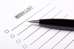 Paper with blank wish list and pen Stock Image