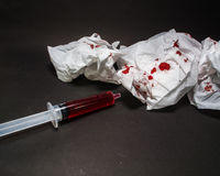 Paper bloody syringes and instruments.Trauma wounds, bleeding. Paper bloody syringes and instruments stock photography