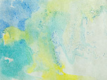 Paper with blue green and yellow paint abstract stock photography