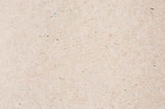Paper board. Beige paperboard with small colorful sprinkles Royalty Free Stock Image