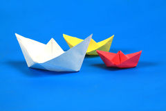 Paper boat. Ships floating in the blue sea Royalty Free Stock Images