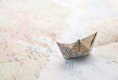 Paper boat. On the map stock image