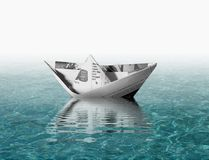 Paper boat. Floating on blue water royalty free illustration