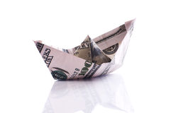 Paper boat. From dollar banknote on white stock images
