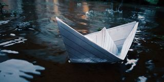 Paper Boat That Is Anchored royalty free stock photo