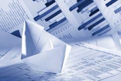 Paper Boat and Bar Graphs royalty free stock image