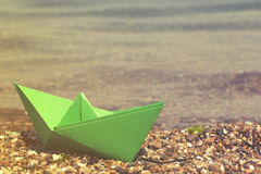 Paper boat. On the beach royalty free stock images