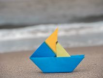 Paper boat on the beach Royalty Free Stock Images