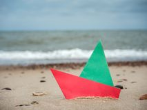Paper boat on the beach Stock Photography