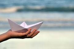 Paper boat on beach Royalty Free Stock Image