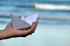 Paper boat on beach Stock Photos