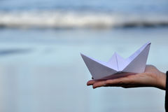 Paper boat on beach Stock Photo