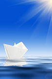 Paper boat and blue water Royalty Free Stock Photos