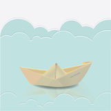 Paper boat in blue waves of paper sea Royalty Free Stock Photography