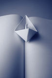 Paper boat on a book Stock Images