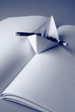 Paper boat on a book Stock Photography