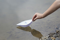 Paper boat childhood float toy river Stock Image