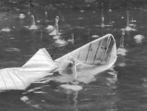 Paper boat drowns like dreams in competition Stock Photography