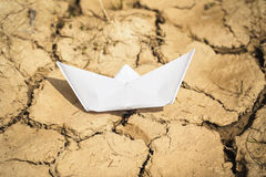 Paper boat  on dry land Royalty Free Stock Photos
