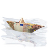 Paper boat with 50 Euros. And crisis Stock Photos