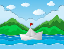 Paper boat floating along river Royalty Free Stock Images