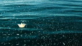 A paper boat floating in the ocean