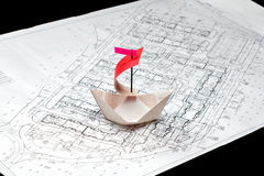 Paper boat floating on the paper waves Stock Images