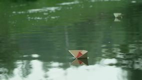 A paper boat floating. On the river stock video footage