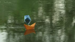 Two paper boats adrift in the river stock footage