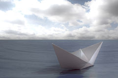 Paper boat floating in the sea Royalty Free Stock Photos