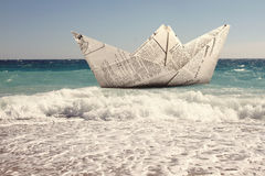 Paper boat floating in a sea Stock Image