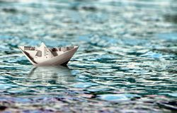 Paper boat floating on water Stock Photography