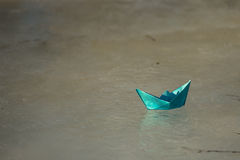 Paper boat floats on the creek royalty free stock photos