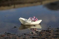 Paper boat with flower Stock Photo