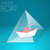 Paper boat in glass pyramid Stock Image