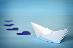 Paper boat and hearts Stock Photo