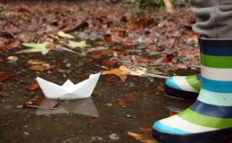 Paper boat and his reflection in fall royalty free stock image