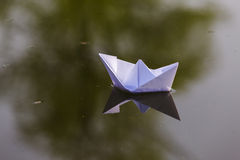 Paper boat in the lake Royalty Free Stock Photo
