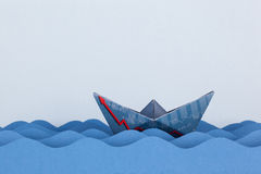 Paper boat made with financial document Royalty Free Stock Photos
