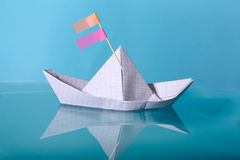 Paper boat made from notebook paper. Royalty Free Stock Photos