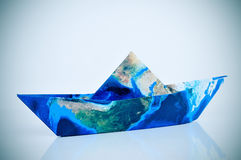 Paper boat made with a world map (furnished by NASA) Royalty Free Stock Images