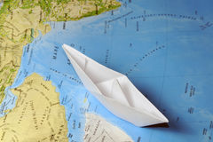 Paper Boat on a map Royalty Free Stock Photography
