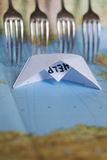 Paper Boat Map Fence Refugees. White paper boat onto world map with Help sign on it stock images