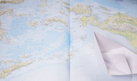 Paper boat on a map Royalty Free Stock Images