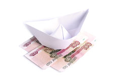 Paper boat on the money Royalty Free Stock Images