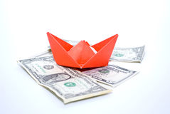 Paper boat and money. Business concept.Paper boat and money Stock Images