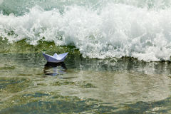Paper boat now die in a huge wave Stock Photo